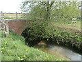SE8437 : Back Delfin drain flowing under Sand Lane by Christine Johnstone