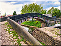 SJ9097 : Ashton Canal, Footbridge at Fairfield Junction by David Dixon