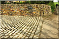 SW9375 : Paving and wall, Porthilly by Derek Harper