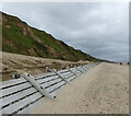 TG3235 : Sea defences at base of Cliff by David Pashley