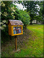 NY4348 : Miniature library on the village green, Wreay by Humphrey Bolton
