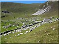 NF1099 : St Kilda - semi-circular wall and stone structures by Rob Farrow