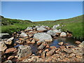 NN4363 : Exposed rocks on the Allt Eigheach by Alan O'Dowd