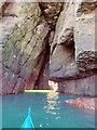 NO8676 : E entrance to a through cave at Powdam by Nigel Feilden