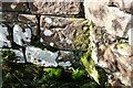 NY5437 : Benchmark on angle of wall on north side of Wain Gate at B6412 junction by Roger Templeman