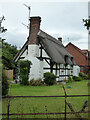SO8651 : Thatched house, Norton, Worcestershire by Chris Allen