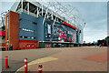 SJ8096 : Old Trafford Football Stadium East Stand, Sir Matt Busby Way by David Dixon
