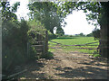 SS8779 : Two gates and a farm field just south of Laleston by eswales