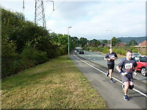 SK1905 : Runners on Coton Lane by Richard Law