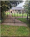 ST4599 : Churchyard entrance gates, Wolvesnewton by Jaggery