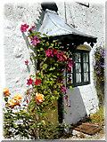 SU1070 : Avebury Doorway with Flowers by Edie Tepper