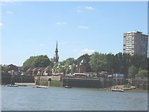 TQ3580 : St Pauls Church Shadwell and the Thames riverfront by David Hawgood