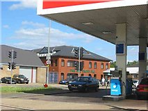 TQ0485 : Petrol Station with offices in the view, New Denham by Jack Hill