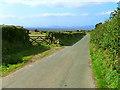 NY0840 : Minor road near Allerby by Nigel Monckton