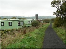 NZ9404 : Cycle path and caravan site by Rob Burke