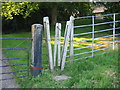SP4961 : Stile at Shuckburgh Church by David Stowell