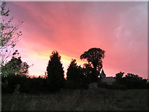 TL3278 : Pidley Church Sunset by Emma Beecroft