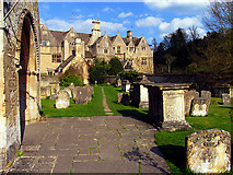SP1106 : Graveyard and Village Buildings at the Church in Bibury by Pam Brophy