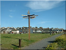 NX3343 : The Signpost and the Statue by David Medcalf