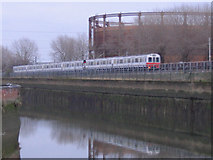 TQ3882 : Tube train and gas holder by Stephen Craven