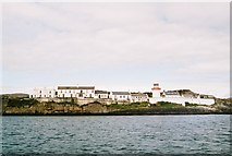 V8126 : Lighthouse at entrance to Crookhaven Harbour by Donald MacDonald