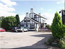 SJ3338 : Greyhound Inn  Street Dinas by John Haynes