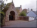 NH9858 : War Memorial Arch, Dyke by Ian R Maxwell