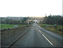 NY6366 : Entering Gilsland on the B6318, looking south south east. by Bill Henderson
