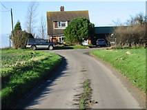 TR2856 : House on road junction. by Nick Smith
