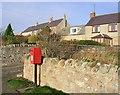 NU0640 : Fenwick village postbox by Walter Baxter