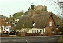 TM1473 : Thatched cottage with Eye Castle behind by Robert Edwards