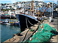 SX9256 : Fishing boat and net, Brixham Harbour by Karen Courtenay