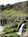 SX1651 : Lansallos: waterfall onto the beach by Brian