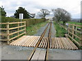 SH5739 : Level crossing at Cynfal by Dewi