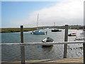 TG0044 : High tide, Morston Quay, towards church at Blakeney by Pauline E