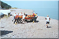 SS9747 : Pebbly beach at Minehead. Practice launch of the lifeboat. by Pauline E