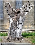 SE2932 : Carved Tree Trunk in Churchyard of St Matthew's, Holbeck by Betty Longbottom