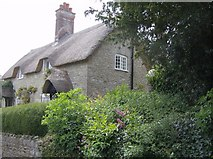 ST5707 : Thatched cottage in Melbury Osmond by Graham Horn