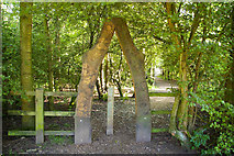SJ8092 : Archway into woodland below the visitors centre, Sale Water Park by Phil Champion