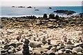 SV8707 : St. Agnes: pillars of stones by Chris Downer