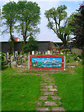 TQ2804 : Mosaic, St Andrew's Churchyard by Simon Carey