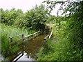 NZ2373 : Flooded bridge Big water by Newbiggin Hall Scouts