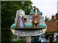 TF9803 : Woodrising Village Sign by Alan Gill