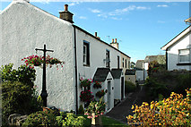 NY0830 : Attractive terrace of houses, High Brigham by Phil Davies
