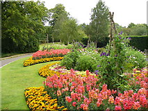 TQ1873 : Flower Beds by Pembroke Lodge by Colin Smith