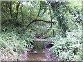 SM9301 : Footbridge over a stream by Jonathan Billinger