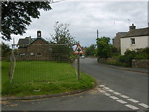 NY7810 : Road sign goal post by William Metcalfe