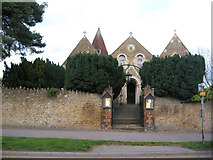 TQ0044 : Holy Trinity Church, Bramley before the trees were cut down by Clare