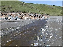 SH1726 : Afon Daron running across Aberdaron beach at low tide by Peter Shone