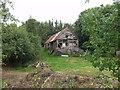 SJ2417 : Derelict barn at Ty Birth by John Haynes